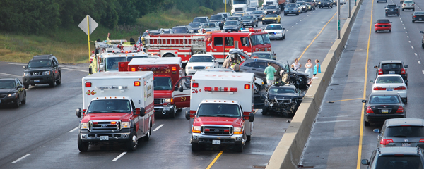 Emergency vehicles on highway at the scene of a crash